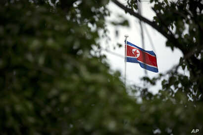 The North Korean flag flies above the North Korean Embassy in Beijing, April 20, 2017. The South Korean news agency says North Korea has detained a third U.S. citizen.