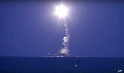In this photo made from the footage taken from Russian Defense Ministry official website, a Russian navy ship on the Caspian Sea launches a cruise missile toward Islamic State targets in Syria, the ministry said, Oct. 7, 2015.