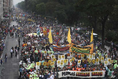 More than 100,000 people march through Manhattan, Sept. 21, 2014 as part of the People's Climate March, a mobilization calling on world leaders to commit to urgent action on climate change and 100 percent clean energy in New York.