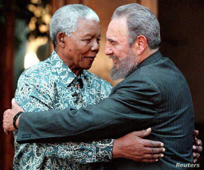 FILE - Former South African President Nelson Mandela (L) hugs Cuba's President Fidel Castro during a visit to Mandela's home in Houghton, Johannesburg in this Sept.  2, 2001 photo.