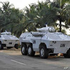 UN armored personnel carriers (APC) park near the Gulf Hotel