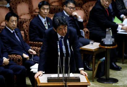 Japan's Prime Minister Shinzo Abe speaks addresses an upper house parliamentary session after reports on North Korea's missile launches, in Tokyo, March 6, 2017.