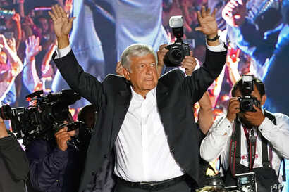 Presidential candidate Andres Manuel Lopez Obrador, of the MORENA party, waves to supporters as he arrives for his closing campaign rally at Azteca stadium in Mexico City, June 27, 2018.