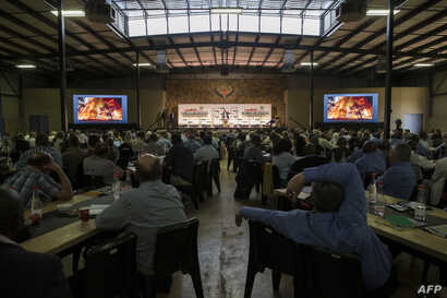 "Farmers, politicians and key role players in the agriculture sector listen to South Africa Deputy President David Mabuza speak as they attend AgriSA, a South African agricultural industry association, at a conference titled ""The Land Solution"" on the..."