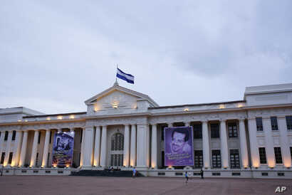 Pro-government posters cover the National Palace on Revolution Square in Managua, Nicaragua, Aug. 1, 2018. With control of the country's universities and other opposition bastions now firmly in government hands, Ortega, who has been in power since 20
