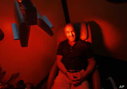 Ric Rooney sits in a newly installed room in his updated tanning salon northeast of downtown Colorado Springs, Colo., March 22, 2017. Former President Barack Obama's Affordable Care Act imposed a 10 percent tax on tanning as a way to help fund provis...