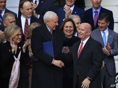 Chairman of the Senate Finance Committee Orrin Hatch (Front-L), Rep. Diane Black (Back-L), House Financial Services Committee Chairman Jeb Hensarling (Back-R), and other lawmakers applaud as House Ways and Means Committee Chairman Kevin Brady  is ack...