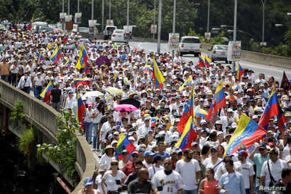 Opposition supporters take part in a rally to demand a referendum to remove Venezuela's President Nicolas Maduro in Caracas, Oct. 22, 2016.
