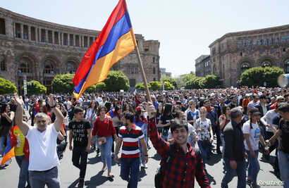 Armenian opposition supporters walk on the street after protest movement leader Nikol Pashinyan announced a nationwide campaign of civil disobedience in Yerevan, Armenia, May 2, 2018.