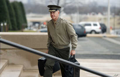 Chairman of the Joint Chiefs Gen. Joseph Dunford arrives at the Pentagon, Jan. 21, 2017 in Washington.
