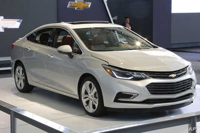 FILE - A Chevrolet Cruze is on display at the Pittsburgh International Auto Show in Pittsburgh, Pennsylvania, Feb. 11, 2016. General Motors, maker of the Cruze model, says consumer demand for the car in the U.S. has forced it to ramp up production in...