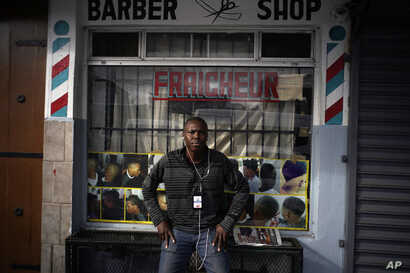 Philocles Julda, 44, poses for a photo in front of a Haitian barbershop in Tijuana, Mexico, Nov. 22, 2018. Julda is part of a group of Haitian immigrants who started the Association of the Defense of Haitian Migrants to give the community a place to ...