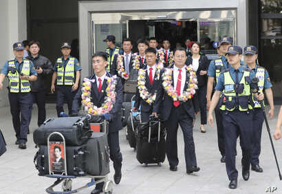 North Korean taekwondo demonstration team members and other officials arrive at Gimpo International Airport in Seoul, South Korea,  June 23, 2017.