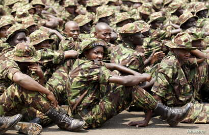 FILE - Members of the Kenya Defense Forces attend prayers as they pay their respects to Kenyan soldiers serving in the African Union Mission in Somalia (AMISOM), who were killed in El Adde during an attack, at a memorial mass at the Moi Barracks in E...