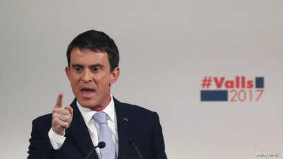 Manuel Valls, former French prime minister and candidate in the left's first-round presidential primaries, attends a political rally as he campaigns in Paris, Jan. 20, 2017.