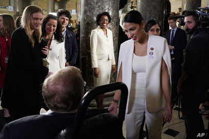Rep. Alexandria Ocasio-Cortez, D-N.Y., arrives to hear President Donald Trump deliver his State of the Union address to a joint session of Congress on Capitol Hill in Washington, Tuesday, Feb. 5, 2019.