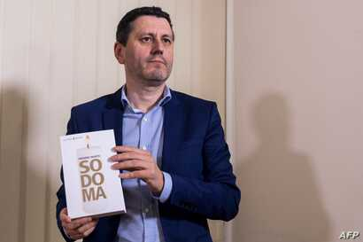 """French writer and journalist Frederic Martel poses during a press conference on Feb. 20, 2019 in Rome about his latest book """"Sodoma"""" that investigates homosexuality in the Vatican."""
