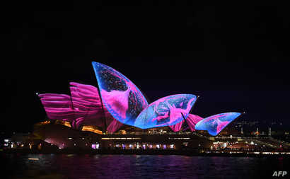 "A light show called ""Vivid"" changes the appearance of the Sydney Opera House in Sydne, Australia, May 26, 2017."