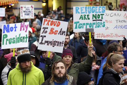 People begin to gather before a rally protesting President Donald Trump's travel ban on refugees and citizens of seven Muslim-majority nations, Jan. 29, 2017.