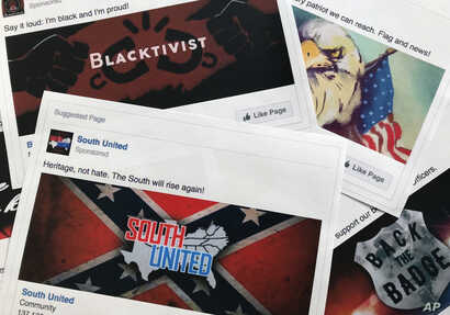 FILE - This Nov. 1, 2017, photo shows prints of some of the Facebook ads linked to a Russian effort to disrupt the American political process and stir up tensions around divisive social issues, released by members of the U.S. House Intelligence Commi...