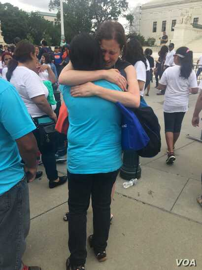 The U.S. Supreme Court's decision that left in place a block on President Barack Obama's plan to extend deportation protections to millions of undocumented immigrants stirred this emotional reaction outside the court building, June 23, 2016. (A. Barr...