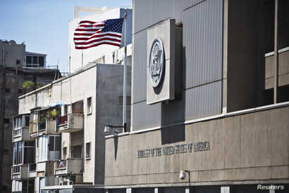 FILE - A flag flutters outside the U.S. embassy in Tel Aviv August 4, 2013.