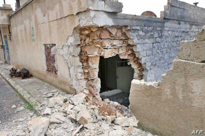 A picture taken on January 26, 2018, shows a damaged house in the Syrian town of Rajo in the Afrin District, Jan. 26, 2018.