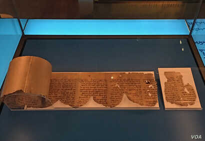 A fragment of the Dead Sea Scrolls is on display at the Museum of the Bible in Washington, D.C., Oct. 24, 2018. (Photo by Diaa Bekheet). The museum announced on Oct. 22, 2018, that five fragments of the ancient manuscripts known as the Dead Sea Scrol...