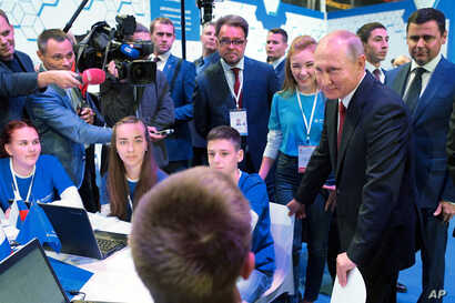 """Russian President Vladimir Putin meets with students in Yaroslavl, Russia, Sept. 1, 2017.  Putin said the development of artificial intelligence raises """"colossal opportunities and threats that are difficult to predict now."""""""