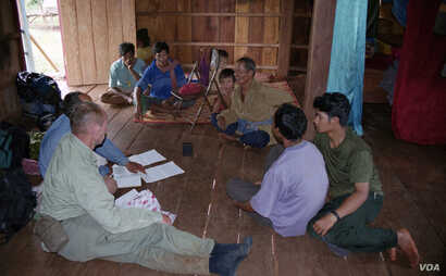 Dr. Sylvain Vogel is talking to Bunong people in Mondulkiri. (Courtesy photo provided by Peter Maguire)