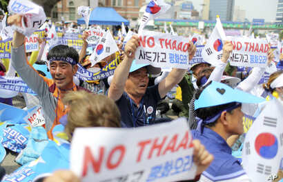 Residents in a rural South Korean town shout slogans in protest of a plan to deploy an advanced U.S. missile defense system called Terminal High-Altitude Area Defense, or THAAD, in their neighborhood, in Seoul, South Korea on July 21, 2016.