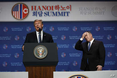 President Donald Trump speaks as Sec of State Mike Pompeo looks on during a news conference after a summit with North Korean leader Kim Jong Un, Thursday, Feb. 28, 2019, in Hanoi. (AP Photo/ Evan Vucci)