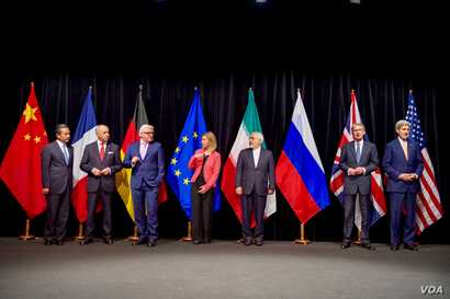 Secretary Kerry poses for a group photo with fellow EU, P5+1 foreign ministers and Iranian Foreign Minister Zarif after reaching Iran nuclear deal, in Vienna, Austria, July 14, 2015.