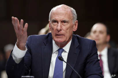 FILE - Director of National Intelligence Dan Coats speaks during a Senate Intelligence Committee hearing about the Foreign Intelligence Surveillance Act, June 7, 2017, in Washington.