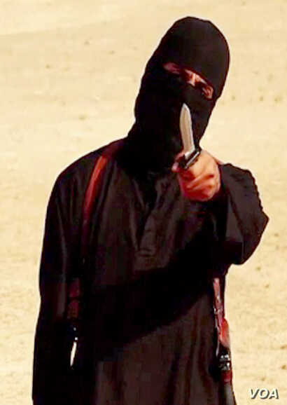 FILE - An image taken from a video released by the Islamic State group purportedly shows a masked militant holding a knife and gesturing as he speaks to the camera before beheading U.S. freelance writer Steven Sotloff.