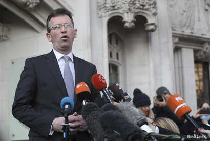 Britain's Attorney General, Jeremy Wright, speaks outside the Supreme Court, in Parliament Square, London, Jan. 24, 2017.