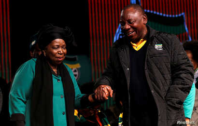 Former African Union chairperson Nkosazana Dlamini-Zuma chats with South Africa's deputy president Cyril Ramaphosa ahead of the African National Congress 5th National Policy Conference at the Nasrec Expo Centre in Soweto, June 30, 2017.
