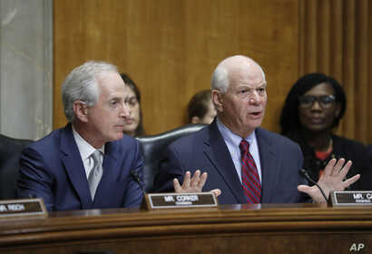 FILE - Senate Foreign Relations Committee Chairman Bob Corker, left, listens as Sen. Ben Cardin speaks during a committee business meeting on the nomination of Rex Tillerson to be secretary of state, Jan. 23, 2017 in Washington.