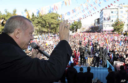 FILE - Turkey's President Recep Tayyip Erdogan speaks during an election rally of his ruling Justice and Development Party, in Burdur, Turkey, Feb. 18, 2019.