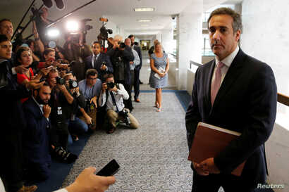 Michael Cohen, personal attorney for U.S. President Donald Trump, talks to reporters after meeting with Senate Intelligence Committee staff as the panel investigates alleged Russian interference in the 2016 U.S. presidential election, on Capitol Hill...
