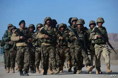 Afghan National Army soldiers march during training by Italian soldiers from NATO's Resolute Support Mission at a Military Training center on the outskirts of Herat, Feb. 9, 2017. The NATO alliance agreed to send more troops to Iraq and Afghanistan t