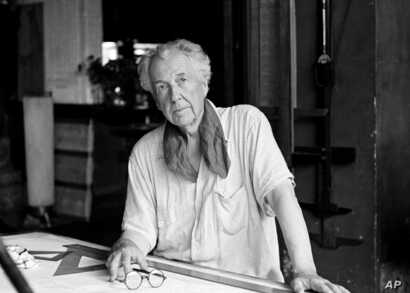 FILE - Architect Frank Lloyd Wright in his studio at his home, Talisien, in Spring Green, Wisconsin, Aug. 16, 1938.