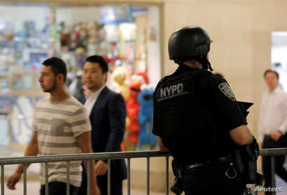 A New York Police Department officer stands guard in Grand Central Station following the Nice terror attack, in New York City, July 15, 2016.