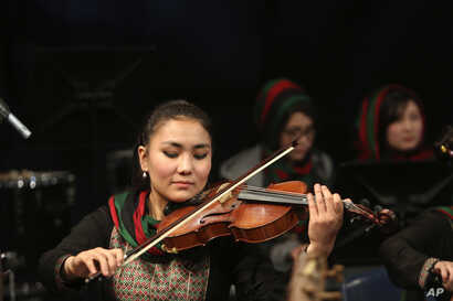 In this Feb. 15, 2017, photo, Zarifa Adiba, 18, plays during a concert in Kabul, Afghanistan.