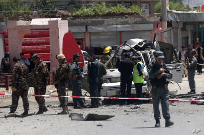 Afghanistan security forces inspect the site of a suicide attack west of Kabul, Afghanistan, May 25, 2016.