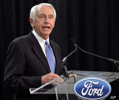 FILE - Steve Beshear, who at the time was Kentucky's governor, speaks to reporters and Ford employees following the announcement of a Ford Motor Co. investment in a Louisville truck plant, Dec. 1, 2015.