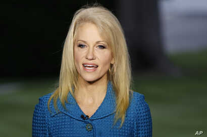 FILE - Kellyanne Conway, senior adviser to President Donald Trump, speaks during an interview outside the White House, in Washington, May 10, 2017. The White House Wednesday posted on its website ethics waivers granted to four ex-lobbyists and numero...