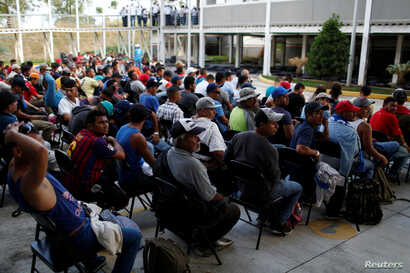 Migrants from Honduras, part of a new caravan from Central America trying to reach the United States, wait to be processed in an immigration facility in Ciudad Hidalgo, Mexico, Jan. 17, 2019.
