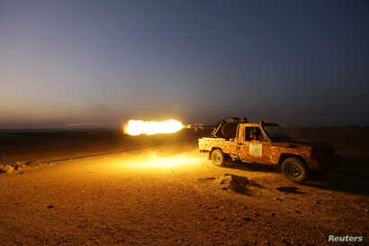 Rebel fighters shoot their weapon towards Syria Democratic Forces (SDF) controlled Tell Rifaat town, northern Aleppo province, Syria October 22, 2016.