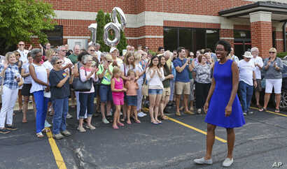 FILE - In this July 29, 2018, photo, rookie Democratic candidate Lauren Underwood greets supporters at the opening of her campaign office in St. Charles, Ill. If elected to the U.S. House in the midterms, Underwood would be the first woman and first ...